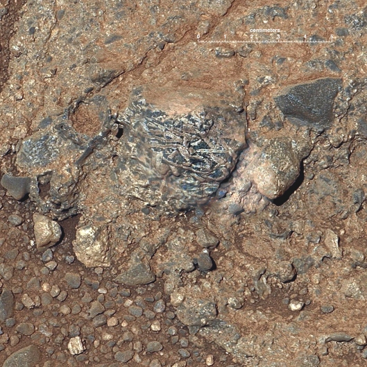 This rock - dubbed Harrison - contains light and dark-colored crystals. Image Credit: NASA/JPL-Caltech/LANL/CNES/IRAP/LPGNa