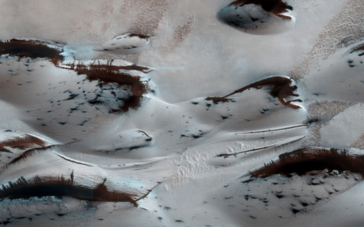 As the spring season begins, the red planet's dunes can be seen emerging from winter's cover. It's not snow; it's dry ice! This image was taken by NASA's Mars Reconnaissance Obiter in January.  Image Credit: NASA/JPL-Caltech/Univ. of Arizona