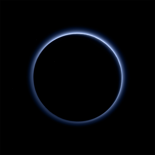 Pluto's blue haze is thought to be similar to that seen at Saturn's moon Titan. Photo and caption courtesy of NASA/JHUAPL/SwRI